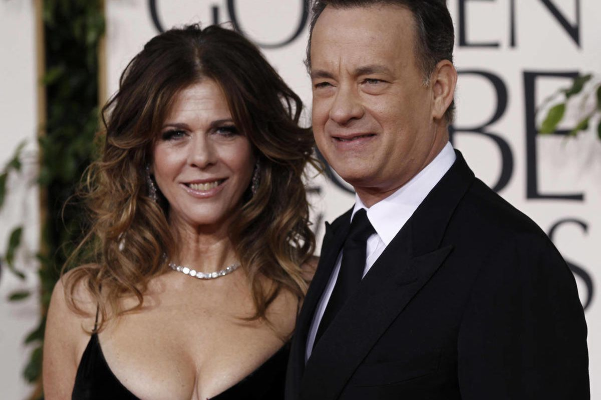 Tom Hanks and his wife Rita Wilson arrive for the Golden Globe Awards Sunday, Jan. 16, 2011, in Beverly Hills, Calif. They were some of the first notable celebrities to catch the COVID-19 virus.