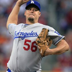 Los Angeles Dodgers starting pitcher Joe Blanton throws to a Cincinnati Reds batter in the first inning of a baseball game, Friday, Sept. 21, 2012, in Cincinnati.