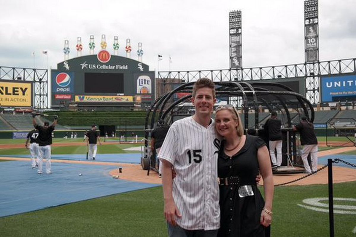 Rich Pearson and his wife, Isobel, on the field during batting practice.