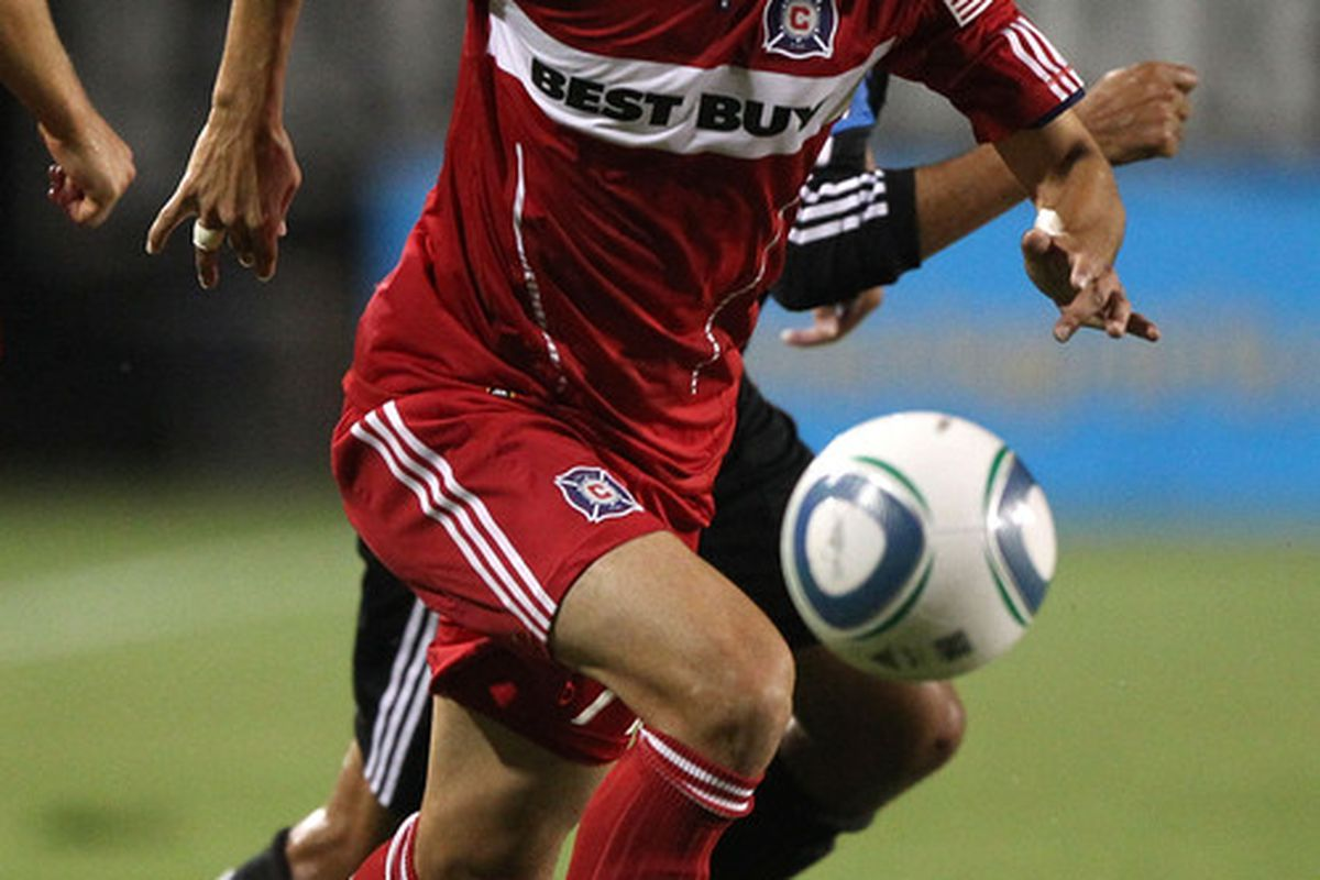 Bratislav Ristic #77 of the Chicago Fire dribbles the ball against the San Jose Earthquakes during an MLS game at Buck Shaw Stadium.
