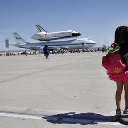 Elizabeth Danirjian, 5, of Santa Clarita, Calif., looks at Space Shuttle Endeavour mounted on NASA's Shuttle Carrier Aircraft (SCA) after it landed at the NASA Dryden Flight Research Center at Edwards Air Force Base, Calif., Thursday, Sept. 20, 2012. Endeavour returned to its California roots after a wistful cross-country journey that paid homage to NASA workers and former Arizona Rep. Gabrielle Giffords and her astronaut husband. (AP Photo/Jae C. Hong)
