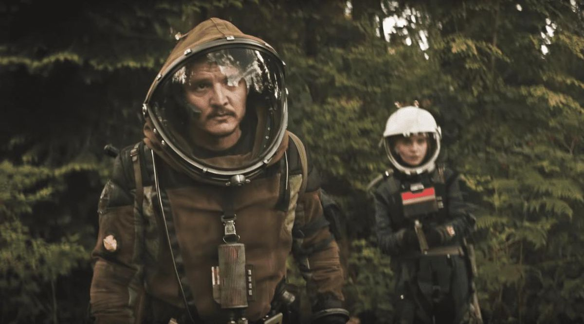 Pedro Pascal wears a space suit while walking in a forest in Prospect