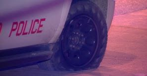A squad car's slashed tire near a fatal police-involved shooting in Archer Heights late Monday. / photo from Network Video Productions
