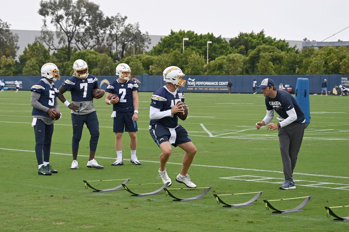 Los Angeles Chargers quarterback Philip Rivers participates in a drill as quarterbacks coach Shane Steichen and quarterbacks Tyrod Taylor, Cardale Jones and Easton Stick watch during organized team activities at the Hoag Performance Center.