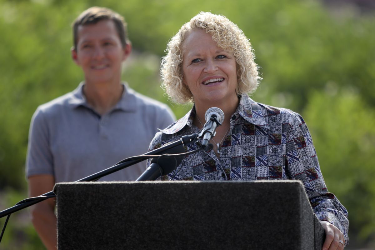 FILE - Salt Lake City Mayor Jackie Biskupski speaks during the opening of the Sego Lily Dam environmental art installation, located on Parley's Bike and Pedestrian Trail at the west end of Sugar House Park, in Salt Lake City on Wednesday, Aug. 1, 2018.