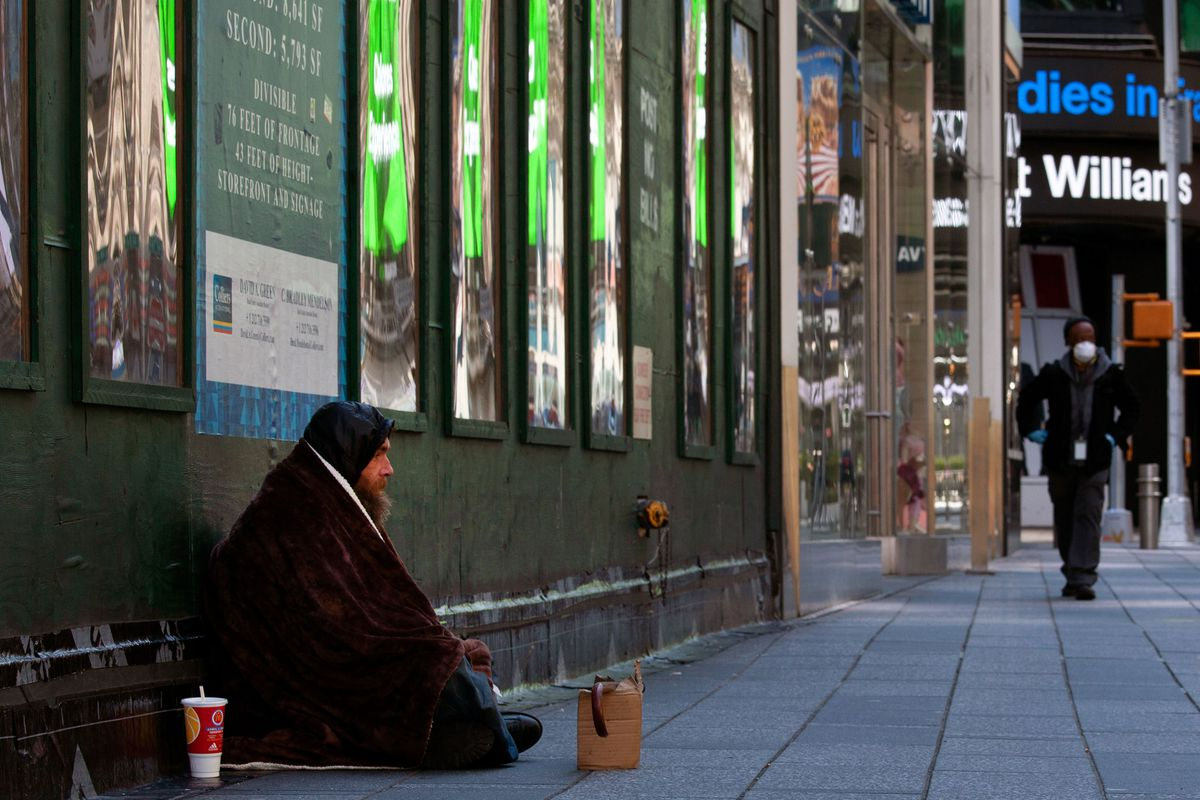 A homeless man camps out in Times Square during the height of the coronavirus outbreak.