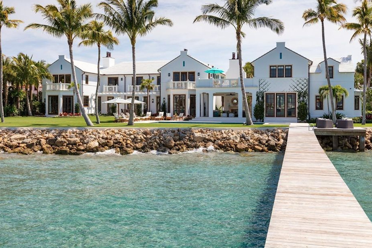 225 Indian Road, Palm Beach, a bayfront mansion with rocks on its shore