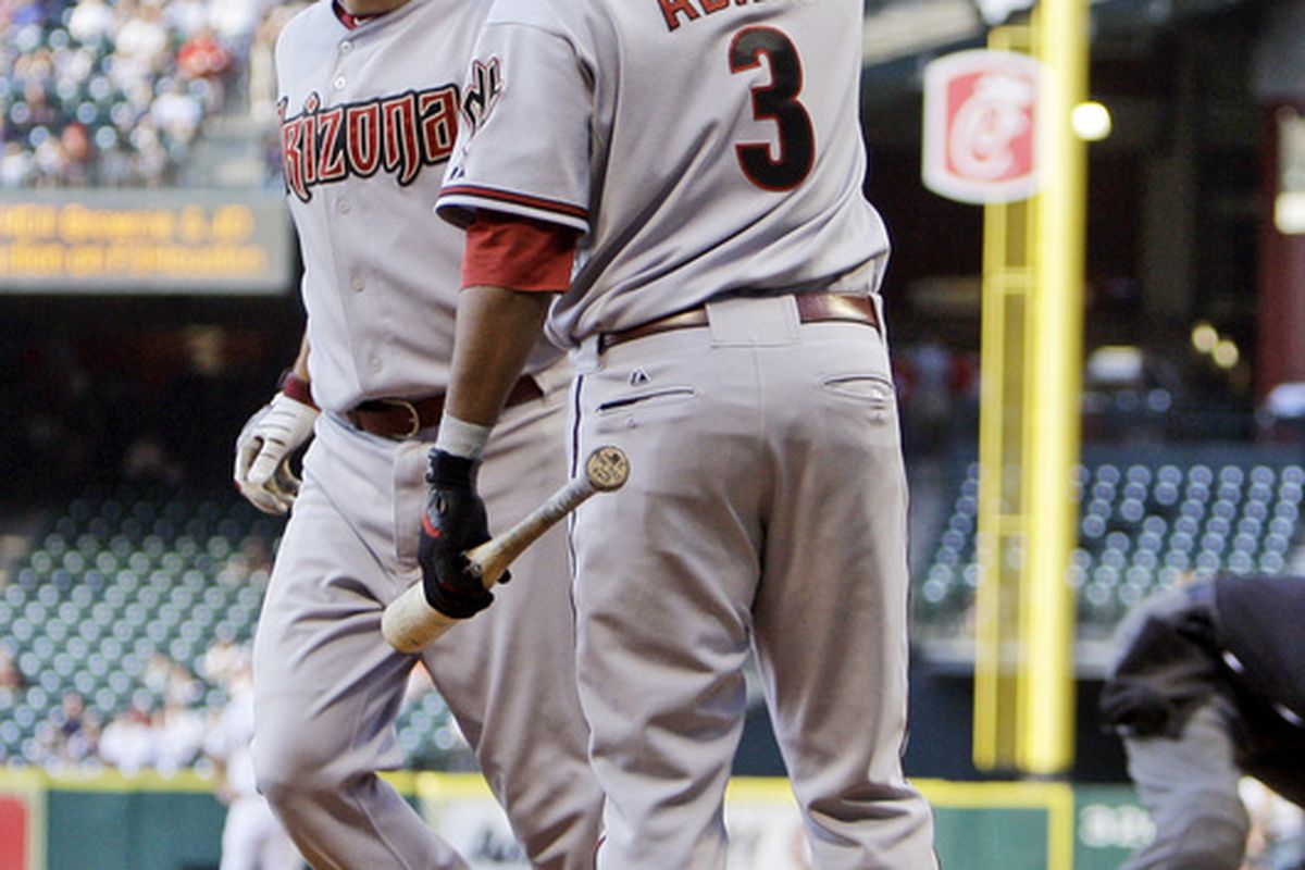 HOUSTON - MAY 06:  Kelly Johnson, left, of the Arizona Diamondbacks receives a high five from Tony Abreu #3 after hitting a home run in the first inning at Minute Maid Park on May 6, 2010 in Houston, Texas.  (Photo by Bob Levey/Getty Images)