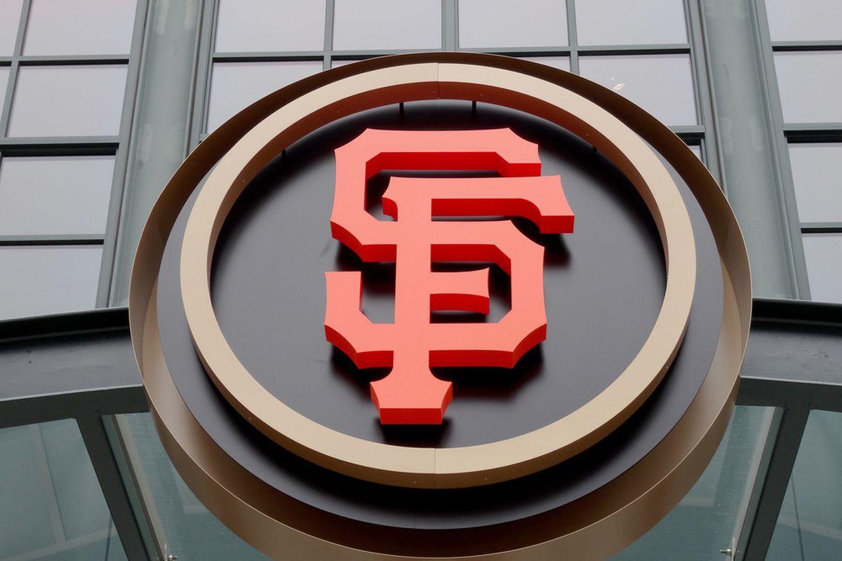 A giant SF Giants logo at the ballpark.