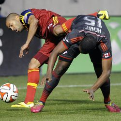 Real Salt Lake forward Alvaro Saborio (15) and Toronto FC defender Doneil Henry (15) collide fighting for control of the ball during a game at Rio Tinto Stadium in Sandy on Saturday, March 29, 2014.