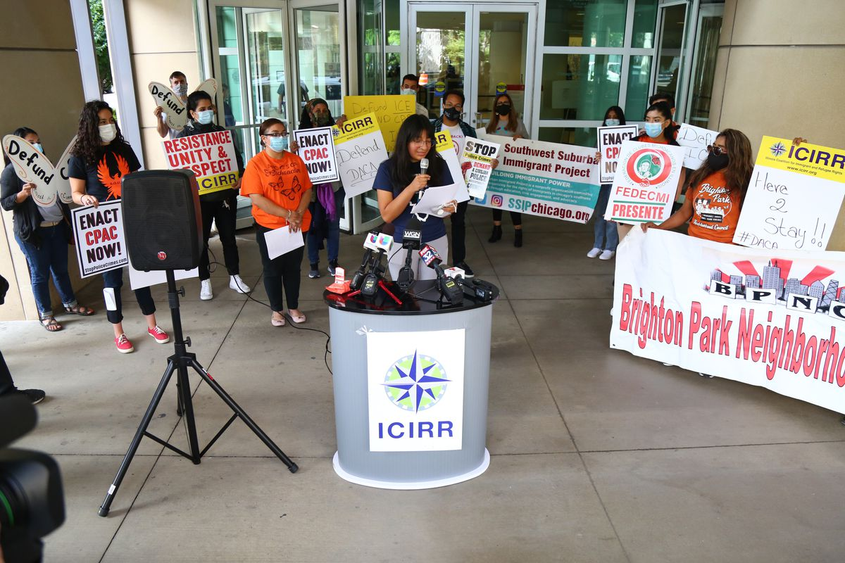 Sandra Diaz, of Mano a Mano Family Resource Center, speaks to the media during a protest outside the Immigration and Customs Enforcement office at 101 W. Ida B. Wells Dr in South Loop, Tuesday, Aug. 4, 2020.