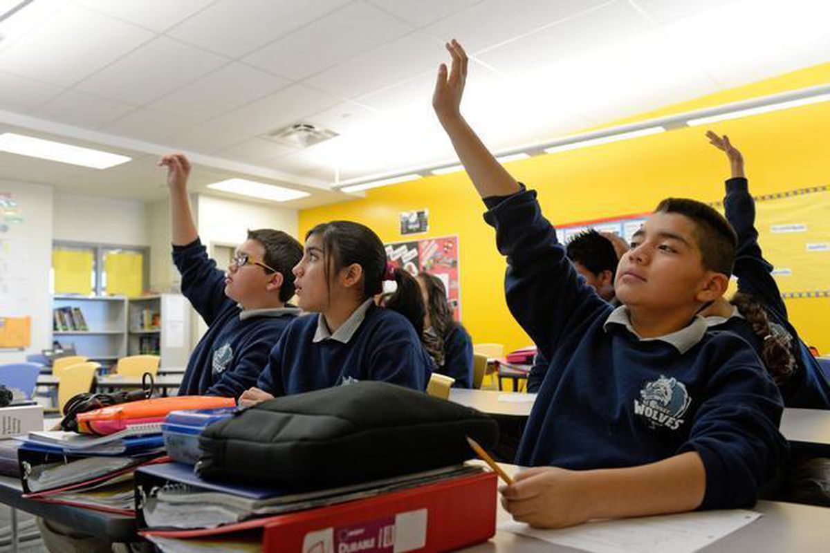 Sixth-graders at DSST: College View answer questions during class in 2014.