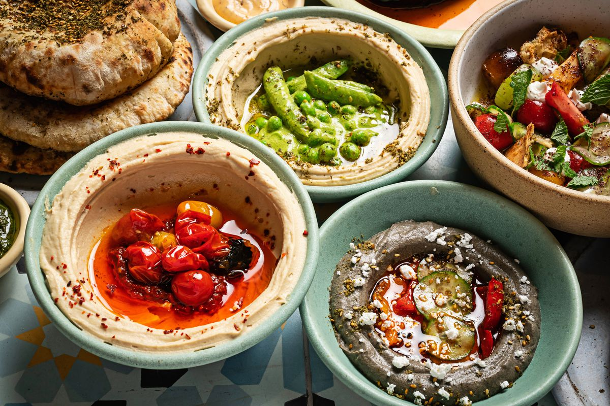 Hummus at Yellow comes with tomato and chil macbucha or fava beans