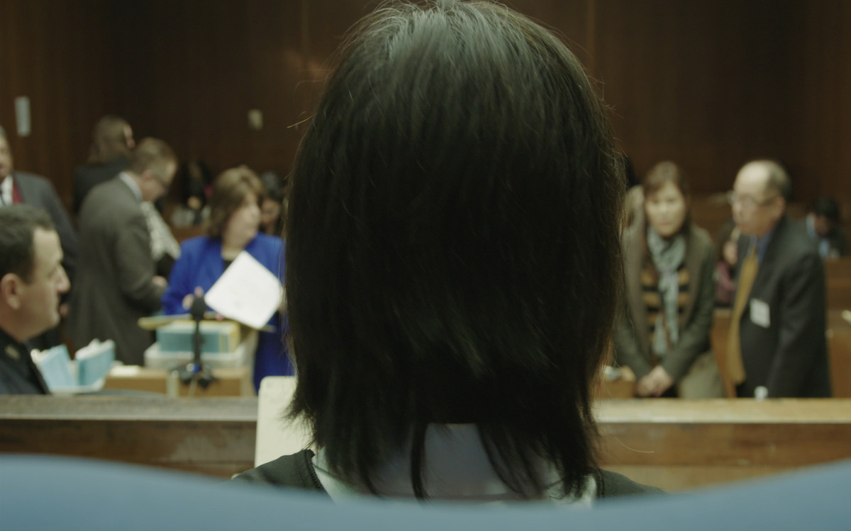 Serita looks across the courtroom in Blowin' Up.