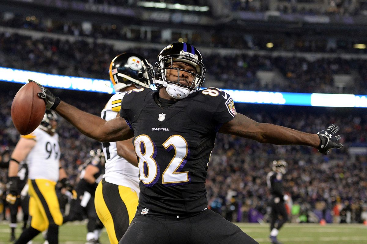 Ravens' WR Torrey Smith celebrating after scoring a touchdown against the Pittsburgh Steelers on Thanksgiving.