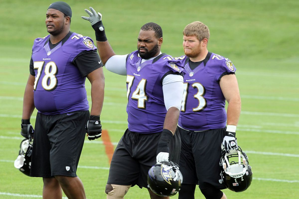 May 23, 2012; Baltimore, MD, USA; Baltimore Ravens tackle Bryant McKinnie (78), tackle Michael Oher (74) and tackle Marshal Yanda (73) during the Baltimore Ravens OTA at the team practice facility. Mandatory Credit: Mitch Stringer-US PRESSWIRE