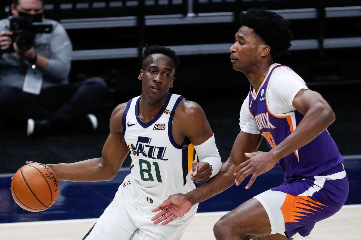 Utah Jazz guard Miye Oni dribbles against Phoenix Suns center Damian Jones during preseason game at Vivint Smart Home Arena.