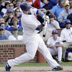 Chicago Cubs' Jake Fox hits a grand slam off New York Mets starting pitcher Bobby Parnell.
