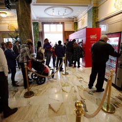 Visitors to the Joseph Smith Memorial Building in Salt Lake City form a line at the Light the World charity vending machines on Friday, Dec. 15, 2017.