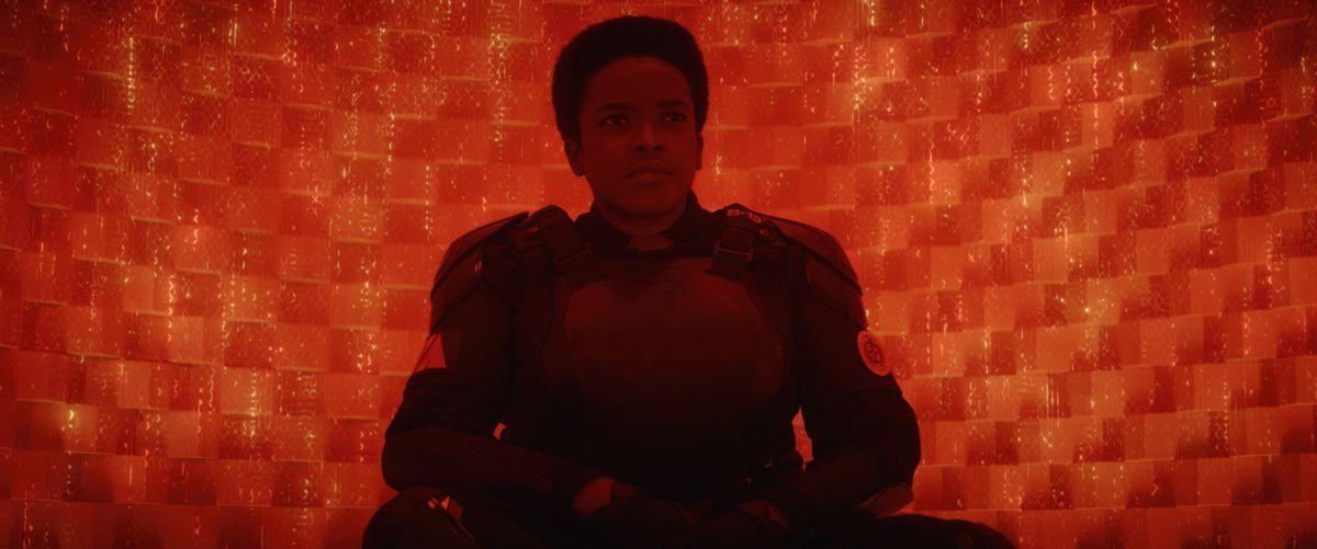 Hunter B-15 (Wunmi Mosaku) sits in her glowing jail cubicle in Loki
