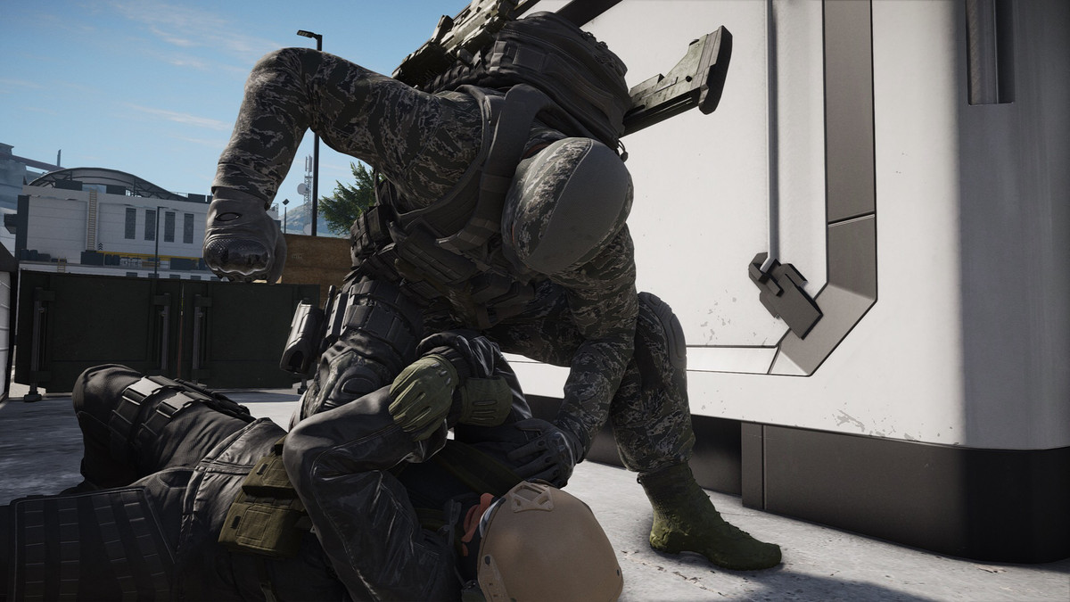 A masked commando with weapons strapped to his back punches a downed foe into submission