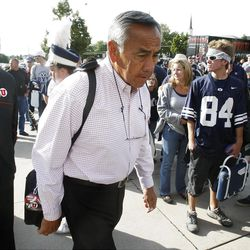 Utah Offensive Coordinator Norm Chow walks into the stadium as BYU and Utah get set to play Saturday, Sept. 17, 2011 at Lavell Edwards Stadium.