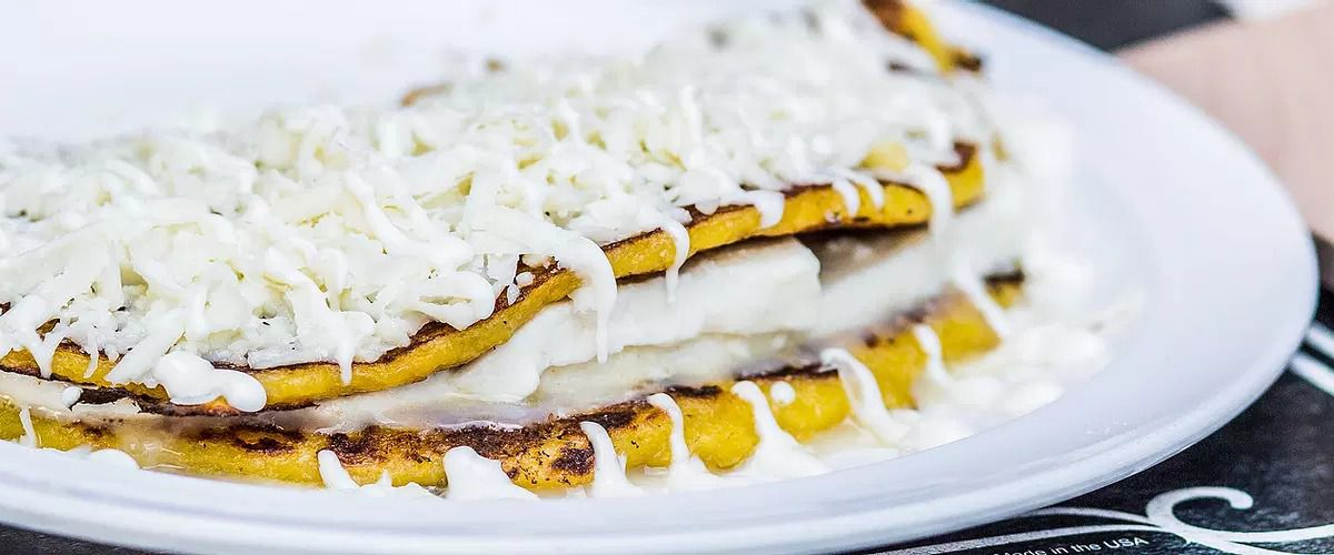 An arepa filled with cheese.