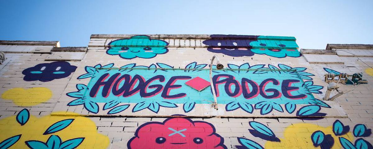 A mural on the wall outside of Hodgepodge Coffeehouse in East Atlanta Village