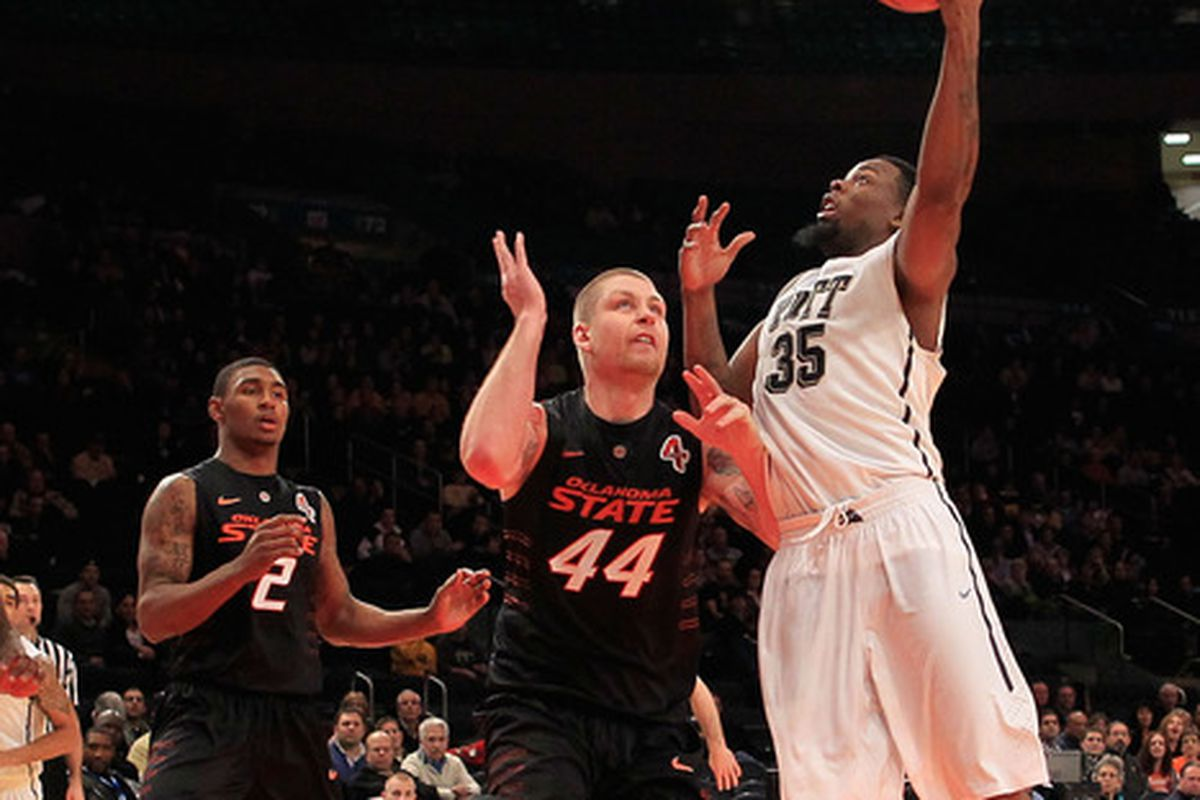NEW YORK, NY - DECEMBER 10: Nasir Robinson #35 of the Pittsburgh Panthers shoots over Philip Jurick #44 of the Oklahoma State Cowboys at Madison Square Garden on December 10, 2011 in New York City.  (Photo by Chris Trotman/Getty Images)