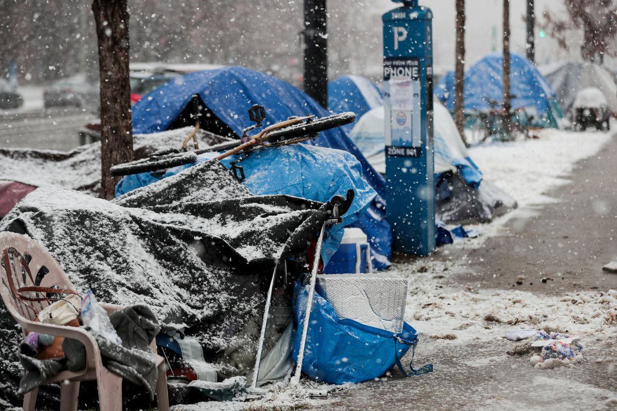 People who are homeless camp along 500 South at Library Square in Salt Lake City on Friday, Nov. 29, 2019.