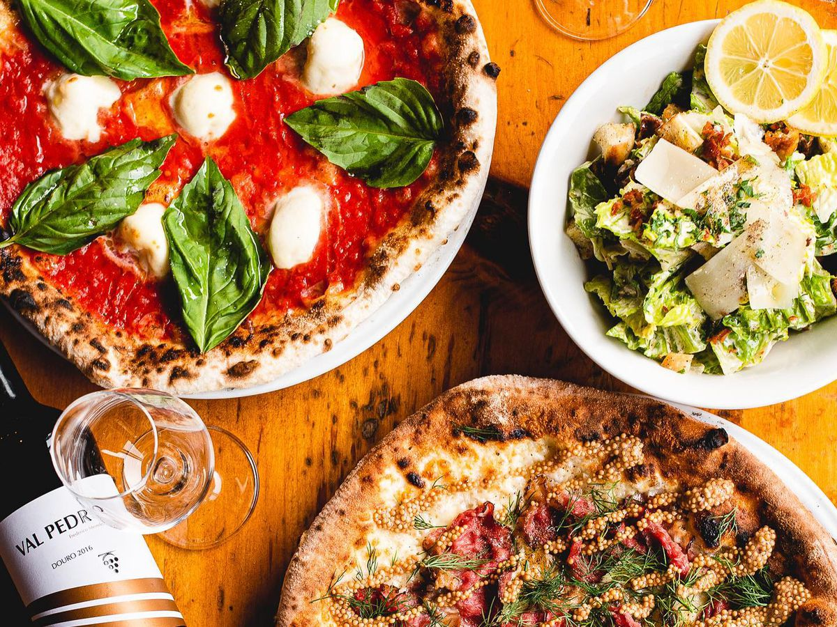 two pizzas and a salad