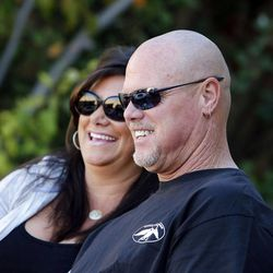 Jim McMahon and his girlfriend, Laurie Navon, laugh during an interview in Layton on Oct. 1.