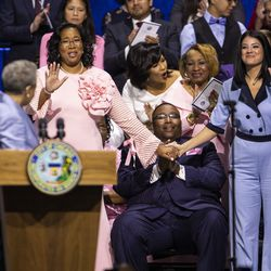 City Treasurer Melissa Conyears-Ervin and City Clerk Anna Valencia cheer as Mayor Lori Lightfoot mentions the number of women of color in top Chicago and Cook County offices during her inaugural address at Wintrust Arena, Monday morning, May 20, 2019.