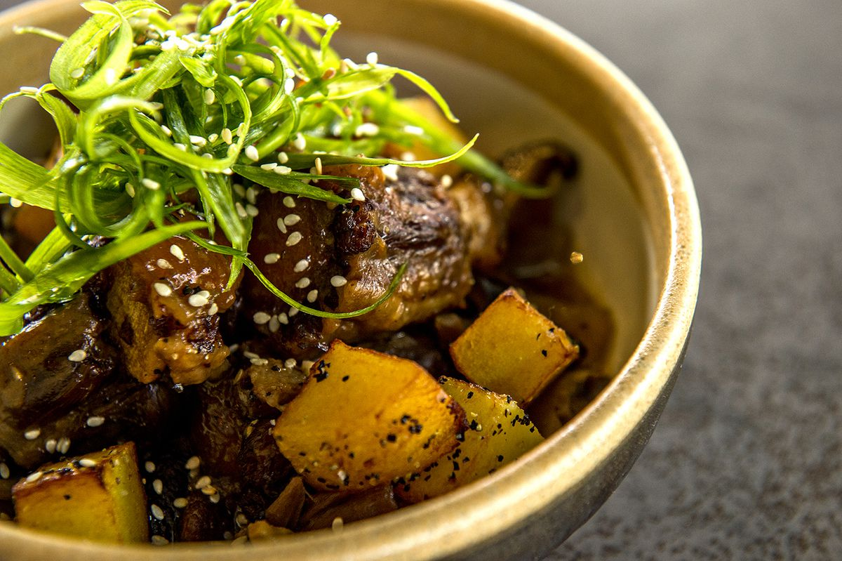Kkori jjim, braised oxtail with confit potatoes and jus.