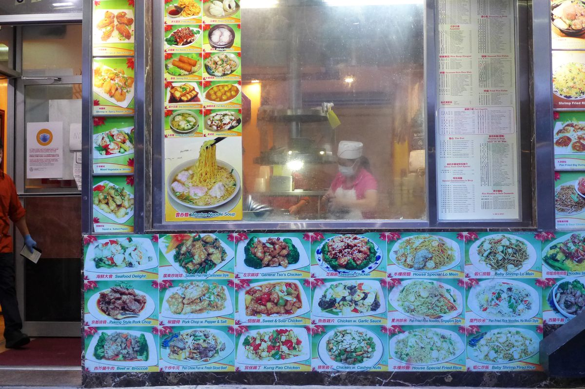 A window surrounded by color pictures of food.