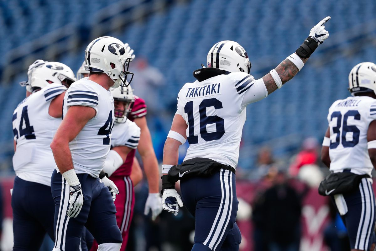 BYU's Sione Takitaki and teammates celebrate a play on Saturday.
