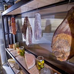Meats and cheese displayed in the new cheese cave
