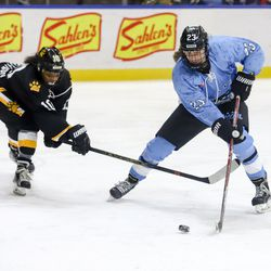 Buffalo Beauts forward Corinne Buie corrals the puck after toe dragging around Boston Pride defender Kaliya Johnson during a NWHL game at HarborCenter in Buffalo, NY on Nov. 11th, 2017.