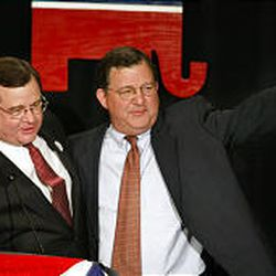 Utah GOP Chairman Joe Cannon, left, congratulates his brother Chris Cannon on his re-election in 2002.