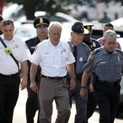 Alexandria, Va. Police Chief Michael Brown, right, and others walk to speak to the media about the shooting in Alexandria, Va., Wednesday, June 14, 2017, where House Majority Whip Steve Scalise of La. was shot at a Congressional baseball practice.  (AP Photo/Alex Brandon)