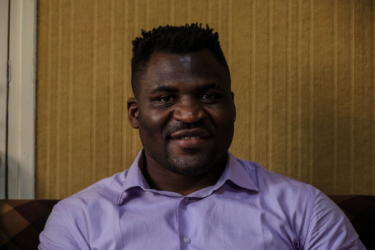 UFC champ Francis Ngannou poses for photos during a 2021 trip to Cameroon.