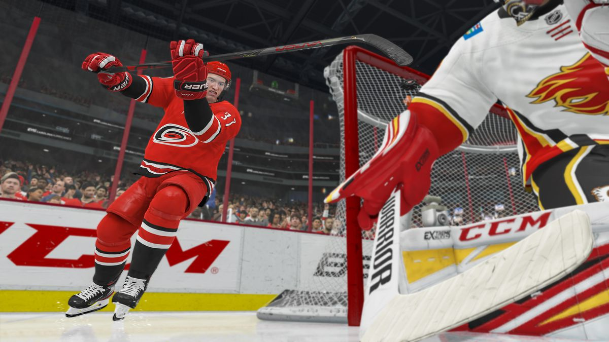 Andrei Svechnikov flips the puck into the net from behind the net in NHL 21