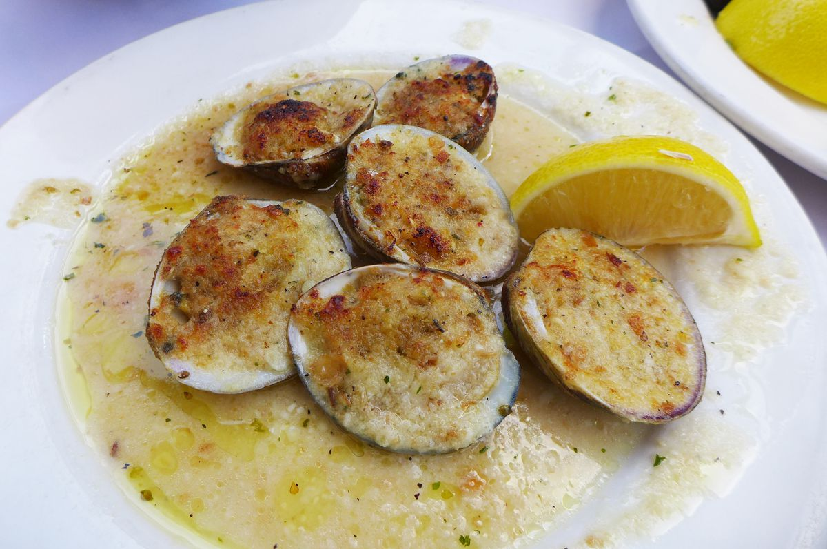 Six small clams on the half shell heaped with bread crumbs.