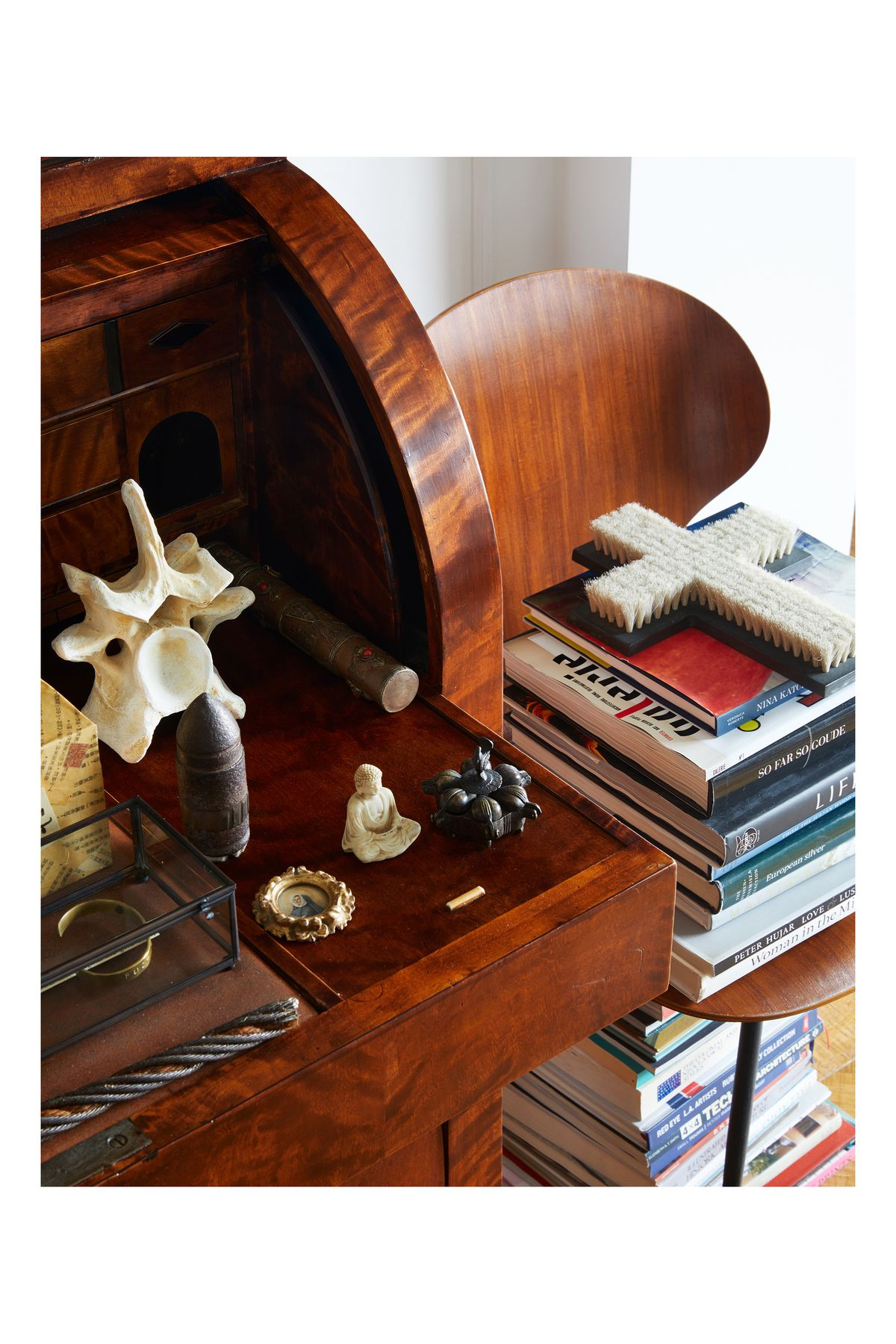 A detail shot showing small objects Campbell displays on a roll-top desk.
