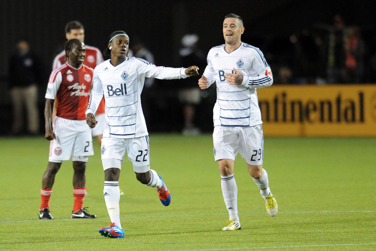 Whitecaps forward Darren Mattocks celebrates with teammate Eric Hassli after a goal. Hassli is one of the many attacking options Vancouver currently have at their disposal, Sebastien Le Toux among the others.