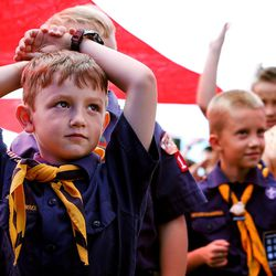Cub Scouts line up under a giant American flag as they take part as American Fork City marks the completion of an 18-month Memorial Garden project at the city cemetery Tuesday, June 14, 2016.