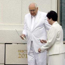 Elder L. Tom Perry steps to the side to allow his wife, Barbara, room to put mortar around the cornerstone of the Brigham City Utah Temple. About 200 took part in the cornerstone ceremony before the temple's dedication Sunday, Sept. 23, 2012.