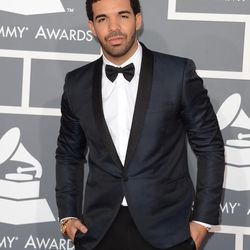 Drizzy Drake in a navy-and-black tux.