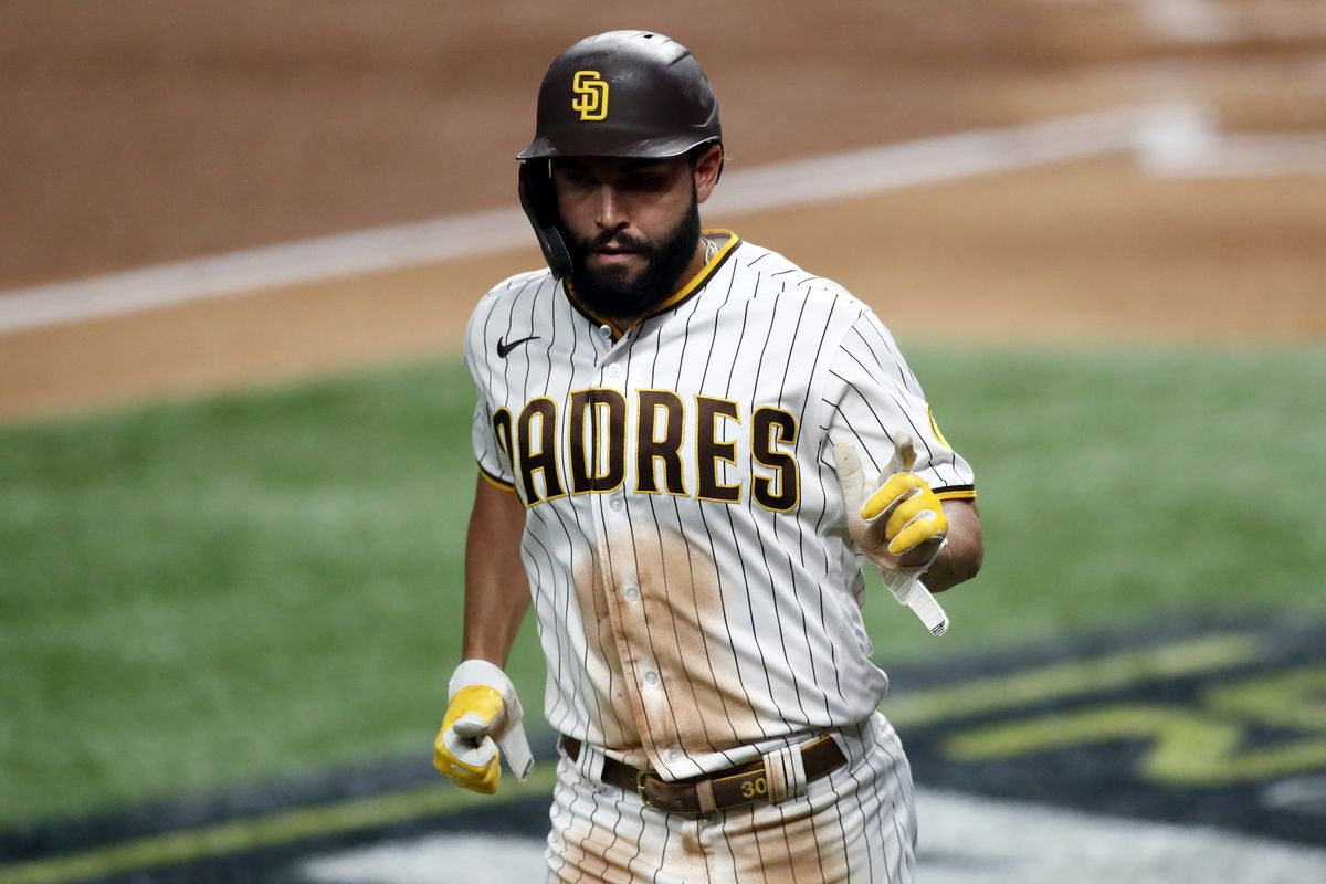 Eric Hosmer #30 of the San Diego Padres scores a run during the second inning against the Los Angeles Dodgers in Game Three of the National League Division Series at Globe Life Field on October 08, 2020 in Arlington, Texas.