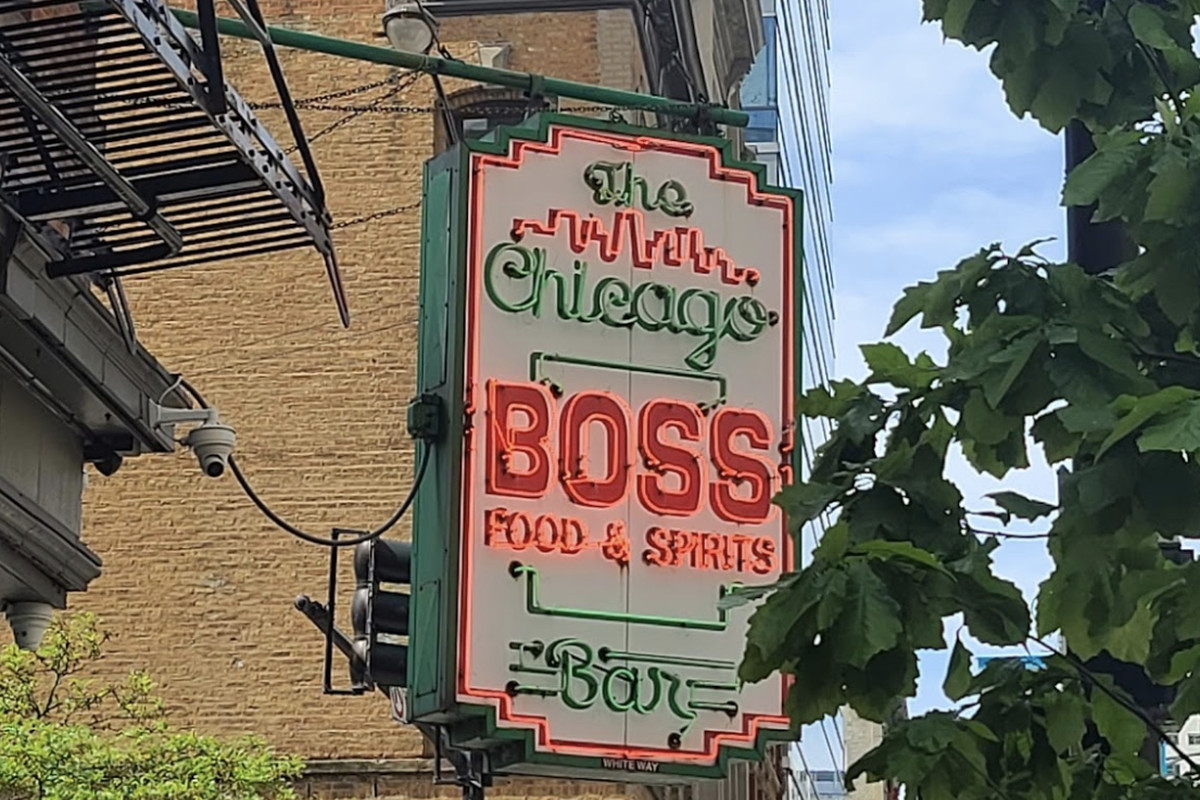 A neon red and green bar sign.